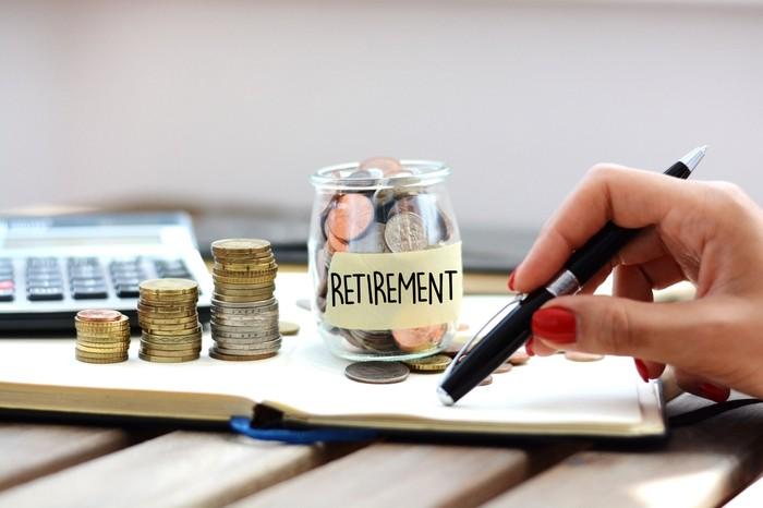Jar of money labeled retirement.