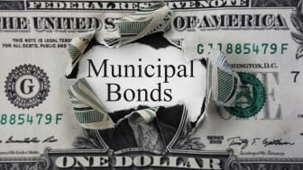 """picture of a dollar bill with a hole in it and """"municipal bonds"""" written in the hole"""