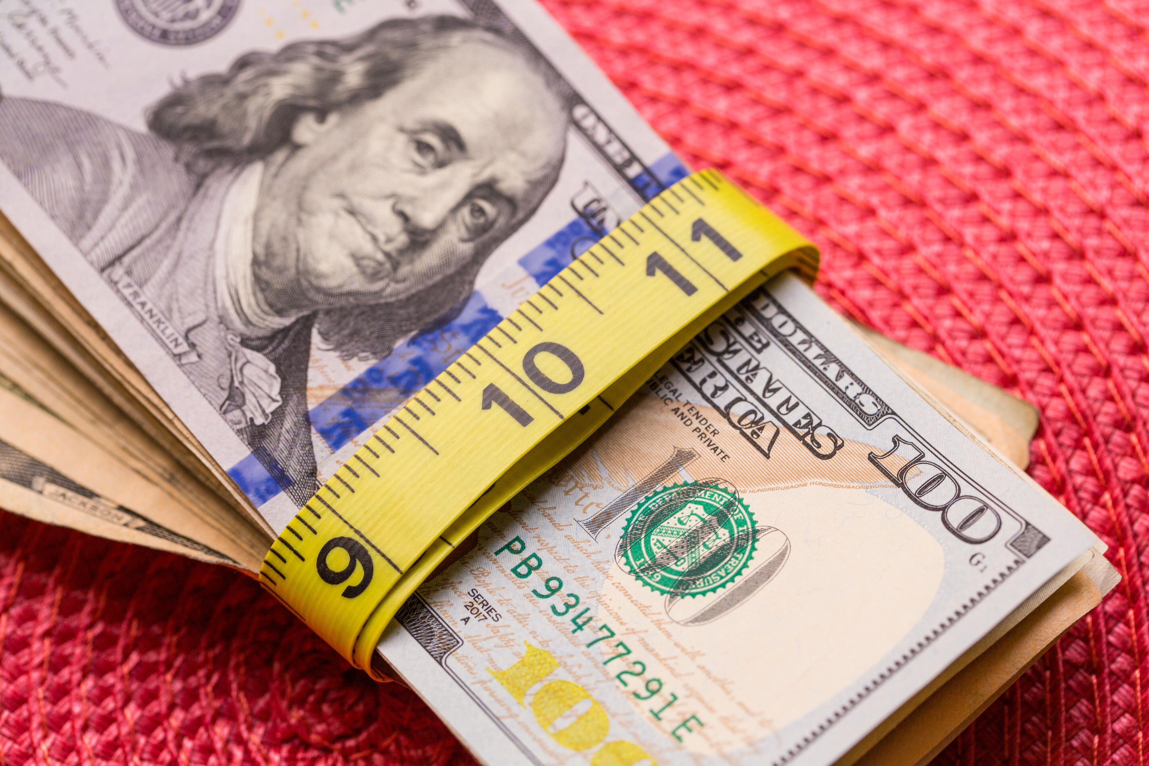 money-cash-dollars-measuring-tape-8110