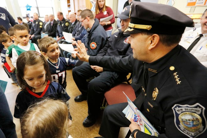 In this file photo, New Bedford police chief Joseph Cordeiro high-fives students. Students of the St. James St. John school held the first annual 1st Responders Appreciation Ceremony at their school in New Bedford, giving thanks to local police officers, firefighters, correctional officers, EMT/Paramedics and City Councilors.