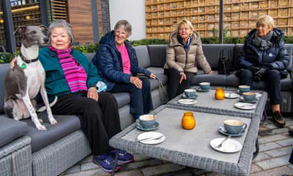 Residents, who include Pi the dog, meet for coffee at Audley's retirement village in Clapham.