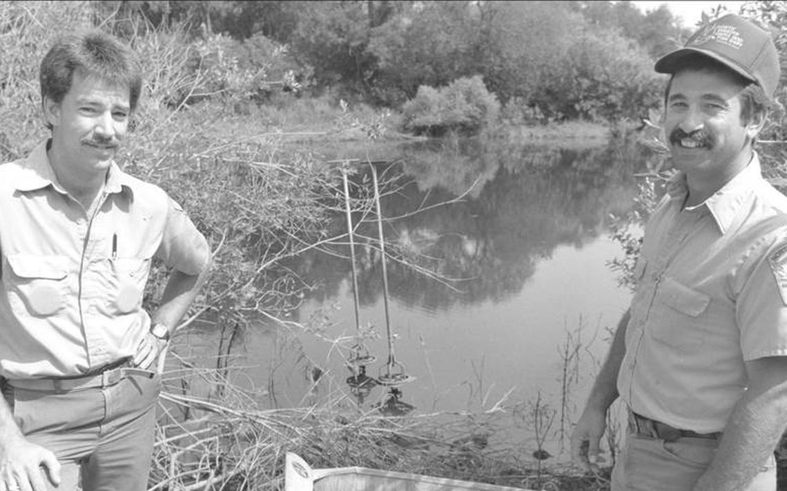 Terry Steinwand (right) and a colleague from the North Dakota Game and Fish Department do fisheries work in this long-ago undated photo.  (Photo/ North Dakota Game and Fish Department)