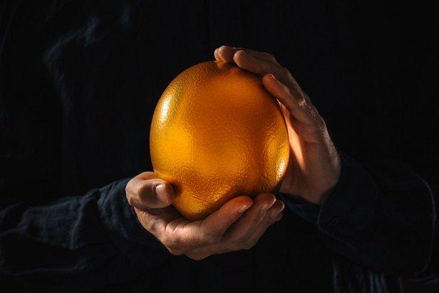 hands holding giant golden egg