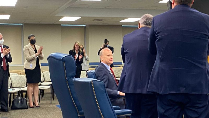 University System of Georgia Chancellor Steve Wrigley, seated, gets a standing ovation from state Board of Regents members and staff during his final scheduled meeting as chancellor on Tuesday, May 11, 2021. Wrigley plans to retire at the end of June. ERIC STIRGUS/ESTIRGUS@AJC.COM.