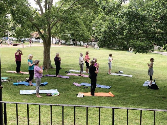 Seniors practice yoga at the Edward King House Senior Center in Newport.