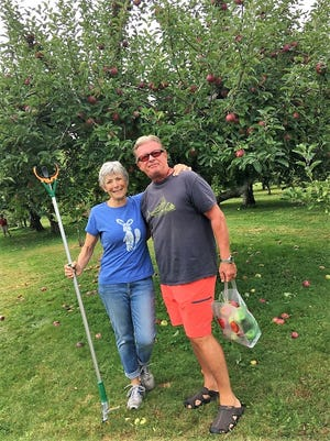 John and Celia Joven chose to retire in Middletown and now fill their days trying Rail Explorers; sailing; and picking apples.
