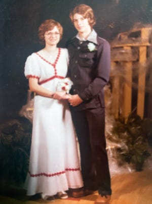 Cheryl Henry, left, and Brad Pheasant in their high school prom photo. After their own divorces, the pair had been dating for over a year.