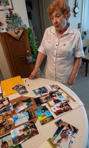 Barbara LeFevre looks over a table of memories from her son's life at her home in Dover Township.