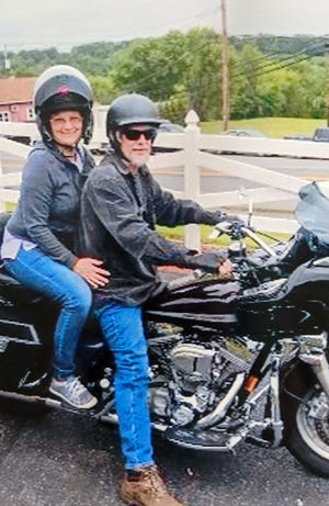 Brad Pheasant an avid motorcycle rider, right, with his girlfriend Cheryl Henry. The pair attended the prom together in high school during the 1970's