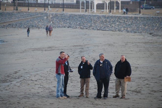 Investigators, including York Police Department Chief Charles Szeniawski, respond to Short Sands Beach the evening of Friday, March 26, to an incident involving a dead body.